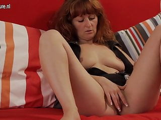Red housewife playing with her hairy pussy