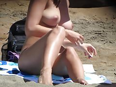 Hot Young Girl Suntanning Nude on the Beach