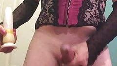 Crossdresser teasing with dildo