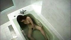 Japanese girl rubs her clit in