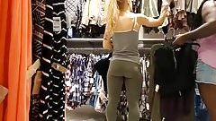 White girl in green tight leggings while shopping