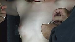 Young shaved pussy brunette has her nipples tortured with nip clips