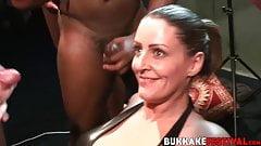 Busty MILFs sucking many dicks at crazy bukkake party