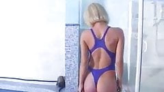 Blond in blue thong swimsuit