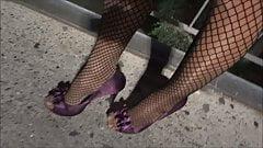 In Fishnet stockings outside