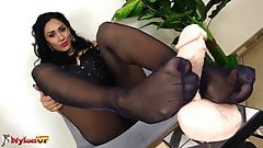 Mistress Alexya footjob in black pantyhose