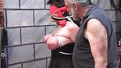 Masked broad has tits tortured by old guy