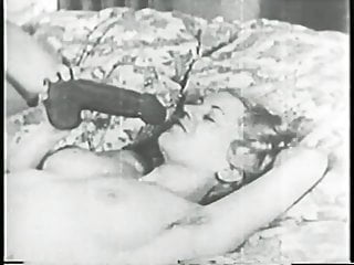 Old-timey flatchested dyke fucks herself with dildo then turns over for more