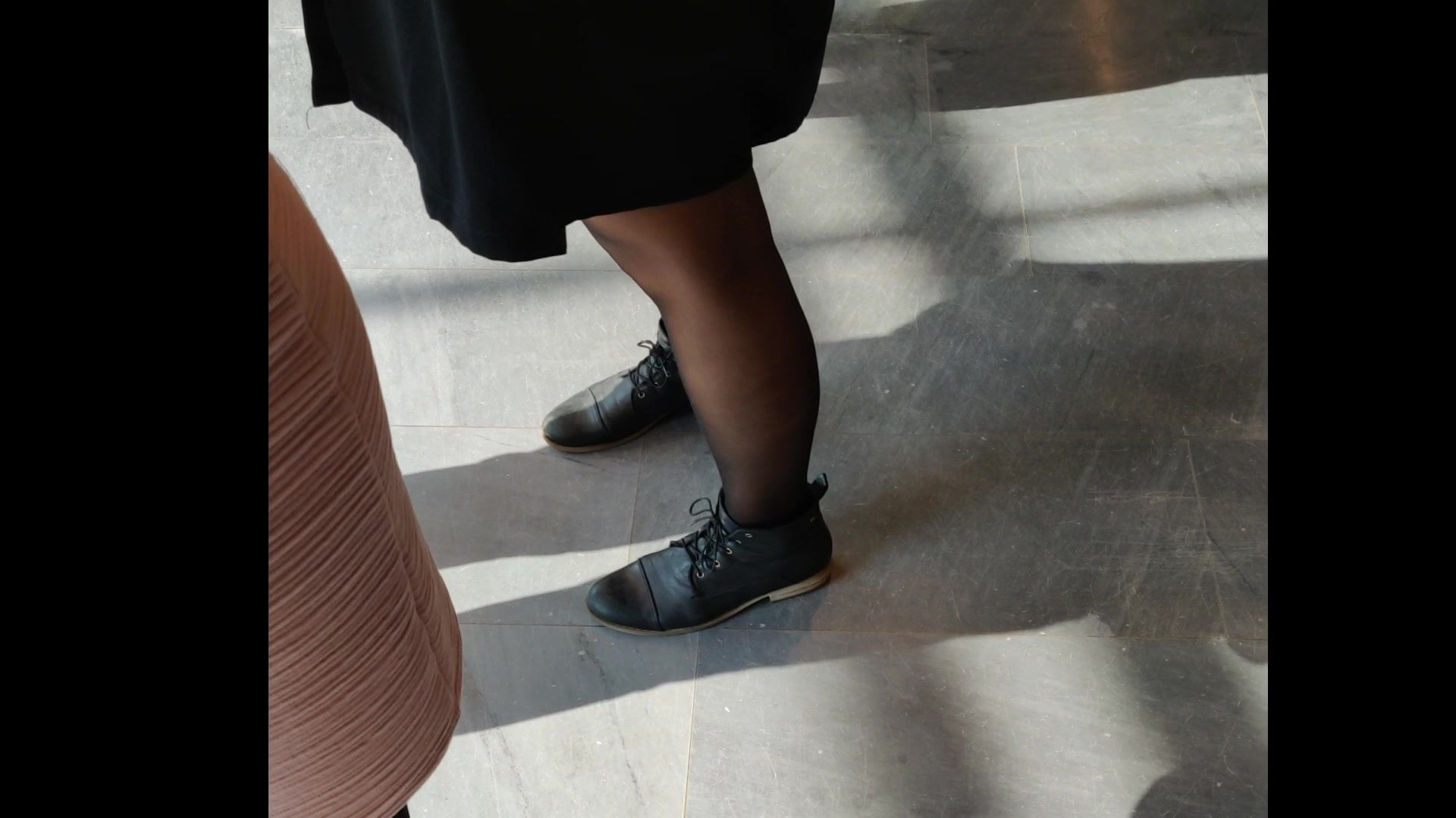 Black tights within the queue