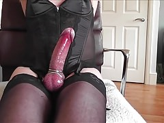 Black Corset, Stockings, Steel Rings and Cum