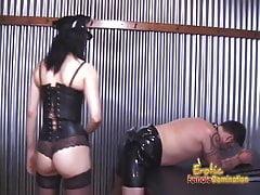 Two ravishing babes enjoy spanking a latex-clad horny stud h