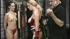 Rope play turns this big tit blonde's jugs purple in sex dungeon basement