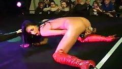 Brunette striper dildoing hard and teasing on stage's Thumb