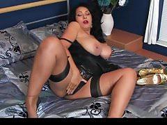Donna Ambrose Returns Home In Black Dress & Gold Heels
