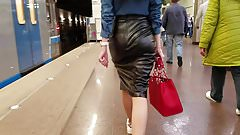 Sexy slim girl in a leather skirt