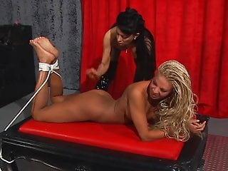 Sexy Natasha has cute blond prisoner in bondage