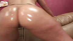 Big booty brunette gets oiled up before riding cock