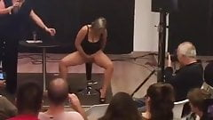 squirting girl showing her skills on a fair