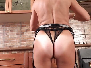 Modern mature mom feeding her hairy pussy on kitchen