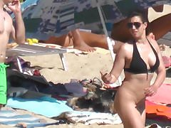pantyless brunette shows her pussy and ass beach