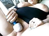 BBW Milf with large breasts uses vibe on up close pussy play