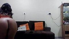 girl stripteasing in the living room