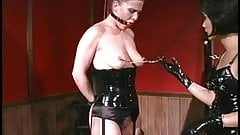 Gagged slut in latex getting ass whipped