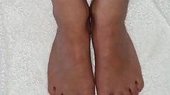 Wife footjob bare feet red nail polish cum