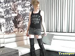 Blonde transsexual uses vibrator on cock
