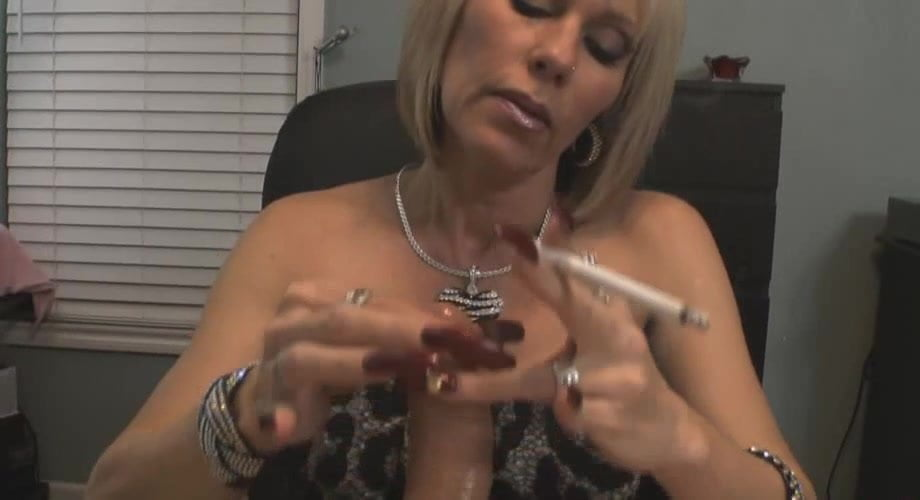 Long nailed milf does it again