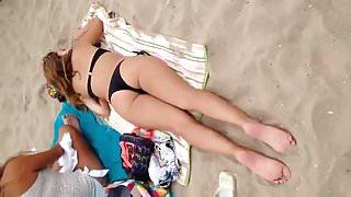 Spying on hot teen sunbathing on beach