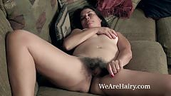 Kelly Lima strips naked on her brown couch