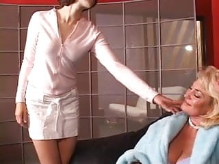 Hot mature blond gets her tits grabbed by hot young brunette