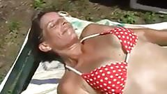 Sunbathing wife garden play