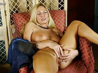 Big breasted American mother masturbating herself to a