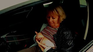 Granny show her tits in the car
