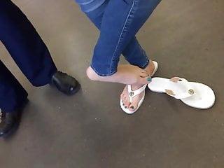 Candid and cute teen feet while out shopping