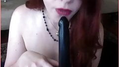 Redhead goddess sucking dildo and spaking her lovely ass