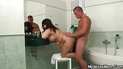 Chubby motherinlaw takes it in the bathroom