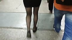 Candid sheer black pantyhose and miniskirt.