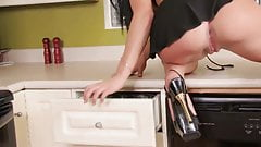 Filthy whore Mandy plays with her sex toys in the kitchen