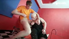 Mature nurse sucking young guy's big cock