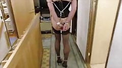 Sissy in gag, chains and anal hook