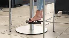sexy feet flip flops dangling, cafe