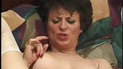 Mature women fuck each other and then play with a cock