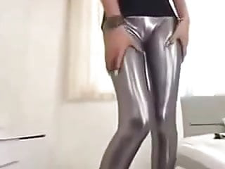 stunning girl in shiny silver leggings