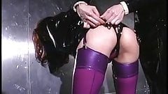 Lesbians in black and purple latex get rough