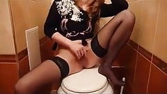 Russian slut in stockings, sucking in the toilet