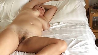 bedroom spycam catches naked MILF