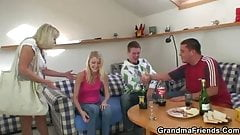 Blonde old granny swallows two big cocks